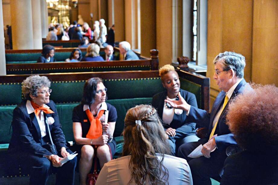 Senator Neil Breslin, right, meets with representatives of the YWCA of the Greater Capital District in the Senate Parlor at the Capitol Tuesday, June 10, 2014, in Albany, NY.  (John Carl D'Annibale / Times Union) Photo: John Carl D'Annibale, Albany Times Union