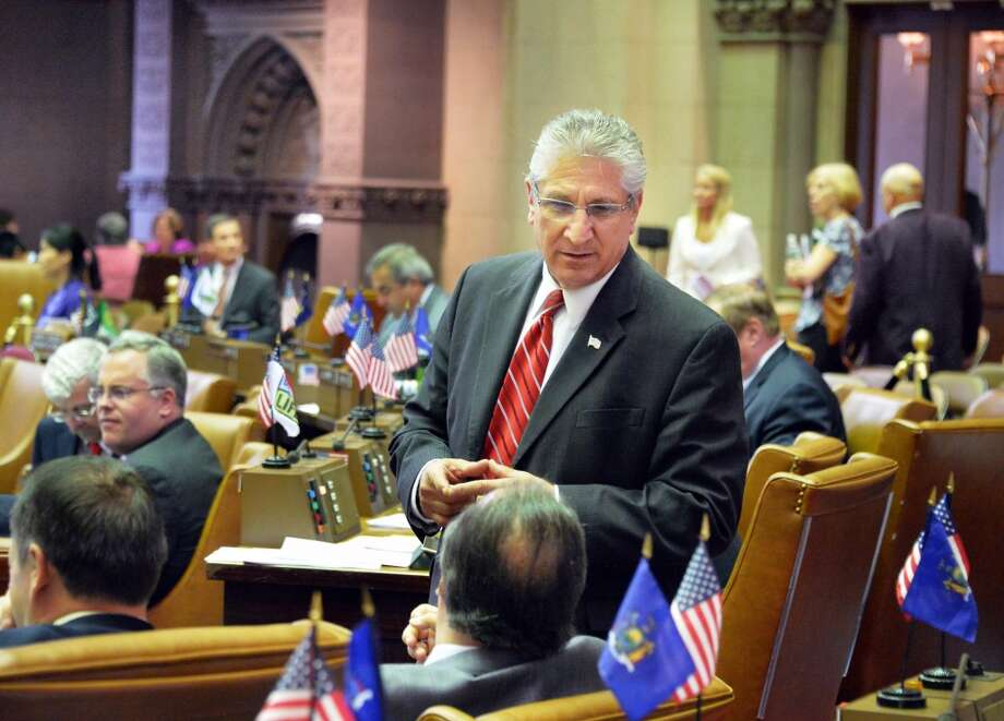 Assemblyman James Tedisco, center, chats with a colleague Tuesday, June 10, 2014, during session at the Capitol in Albany, NY. (John Carl D'Annibale / Times Union) Photo: John Carl D'Annibale, Albany Times Union
