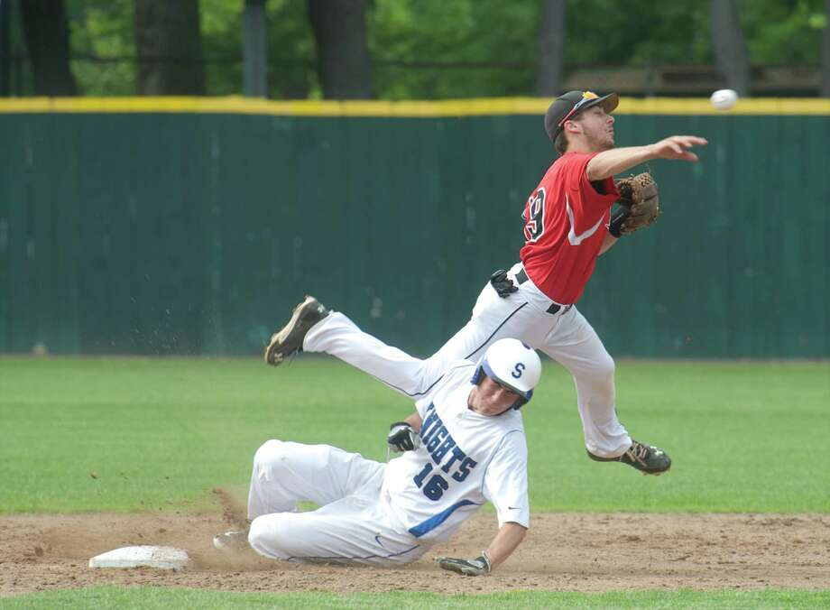 Ward's Nichk Nardone, #19, throws to first to try and make the double play as Southington's Michael Rogalski, #16, slides into second during the Class LL state baseball semifinals between Southington and Fairfield Warde high schools, played at Muzzy Field in Bristol, Conn, on Tuesday, June 10, 2014. Rogalski was out at second but Nardone did not complete the double play. Photo: H John Voorhees III / The News-Times Freelance