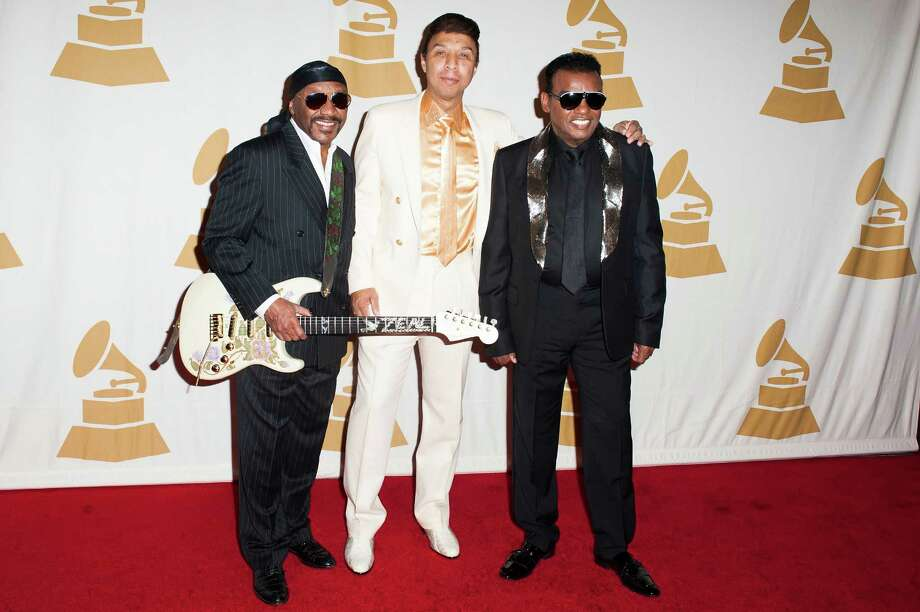 "The Isley Brothers went from a trio to a full-fledged band when they introduced younger brothers Ernie (lead guitar) and Marvin (bass) and Rudolph Isley's brother-in-law Chris Jasper (keyboards, synthesizer) in 1973. The group eventually broke up in 1983, as Ernie, Marvin, and Jasper began performing as ""Isley-Jasper-Isley. O'Kelly Isley died in 1986 at age 48 from a heart attack. Rudolph and Ronald Isley attempted a side-project until Rudolph retired to join the Christian Ministry, leading Ronald to rejoin the other performing brothers in 1991. Ronald and Ernie Isley still perform under the Isley Brothers name. From left to right: Ernie Isley, Chris Jasper, and Ronald Isley attend the GRAMMY Foundation's Special Merit Awards ceremony at The Wilshire Ebell Theatre on January 25, 2014 in Los Angeles, California.  Photo: Jennifer Lourie, Getty / 2014 Jennifer Lourie"
