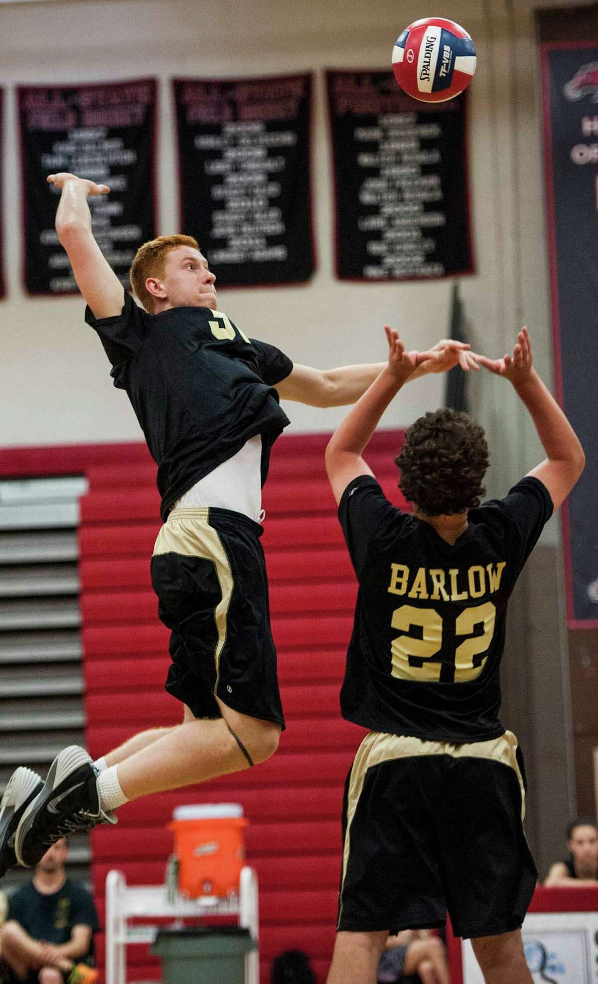 Joel Barlow high school's Chatham Studer goes up to spike the ball during a CIAC class M semifinal boys volleyball game against Newington high school played at Fairfield Warde high school, Fairfield, CT on Tuesday, June 10th, 2014.