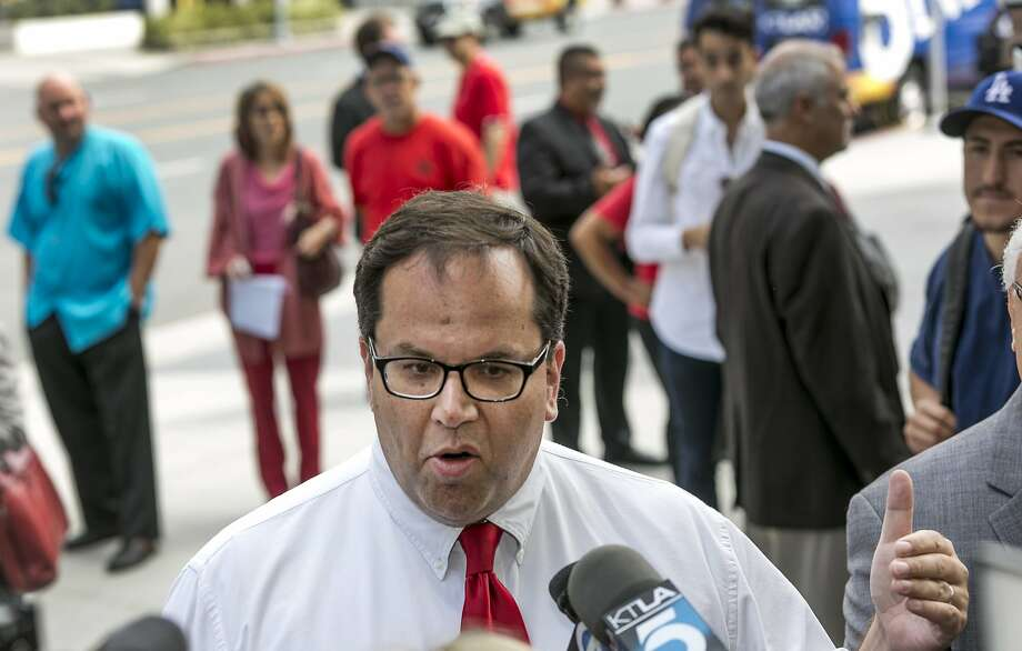 Alex Caputo-Pearl, president elect of United Teachers Los Angeles, takes questions on about the verdict of the Vergara v. California lawsuit in Los Angeles Tuesday, June 10, 2014. Photo: Damian Dovarganes, Associated Press