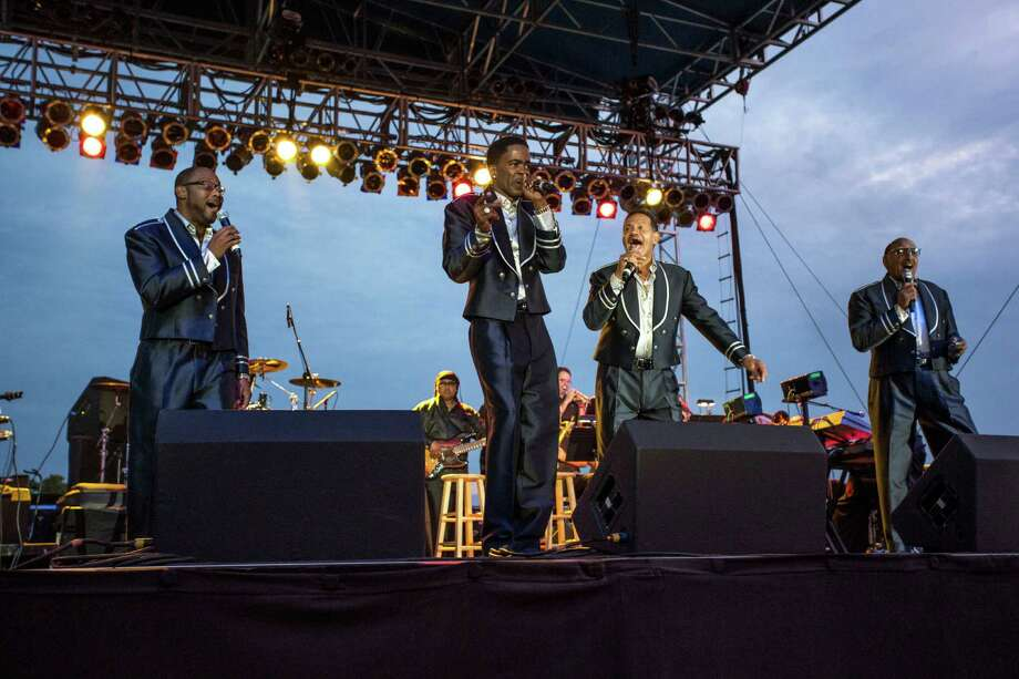 """The Four Tops haven't gone through nearly as many iterations as The Temptations since their inception in the 1950s. In fact, The Four Tops did not change their lineup since 1953 until 1997 when Lawrence Payton died. Theo Peoples (formerly of the Temptations) took up the lead singer role and the group continued to perform. Levi Stubbs suffered a stroke in 2000 and Renaldo Benson died in 2005 of lung cancer. Levi Stubbs died in 2008. People's dropped out in 2011. Abdul """"Duke"""" Fakir is the only surviving founder of the Four Tops. Here, the current members perform during the 2013 Biltmore Concert Series at the Biltmore on August 23, 2013 in Asheville, North Carolina. Photo: Alicia Funderburk, Getty / 2013 Alicia Funderburk"""