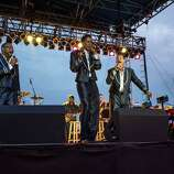 "The Four Tops haven't gone through nearly as many iterations as The Temptations since their inception in the 1950s. In fact, The Four Tops did not change their lineup since 1953 until 1997 when Lawrence Payton died. Theo Peoples (formerly of the Temptations) took up the lead singer role and the group continued to perform. Levi Stubbs suffered a stroke in 2000 and Renaldo Benson died in 2005 of lung cancer. Levi Stubbs died in 2008. People's dropped out in 2011. Abdul ""Duke"" Fakir is the only surviving founder of the Four Tops. Here, the current members perform during the 2013 Biltmore Concert Series at the Biltmore on August 23, 2013 in Asheville, North Carolina."