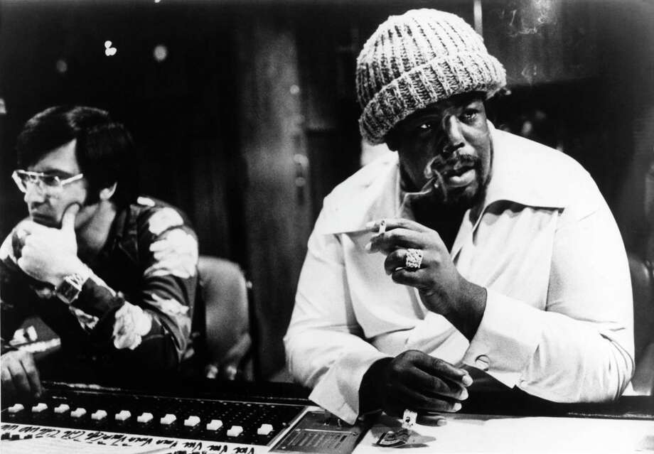 """Barry White became the ultimate voice in romantic music with songs such as, """"You're The First, the Last, My Everything"""" (1974) and """"Can't Get Enough of Your Love"""" (1974).   Here, Barry White is seen in a recording studio behind mixing desk, wearing woolen hat and smoking a cigarette in 1970. Photo: Echoes, Getty / Redferns"""