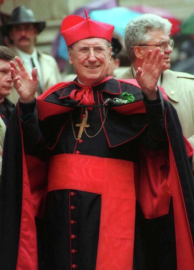 New York's Cardinal John J. O'Connor raises his hands near New York's St. Patrick's Cathedral, March 17, 1993 during the annual St. Patrick's Day parade. Photo: MONIKA GRAFF, AP Photo/Monika Graff / Associated Press