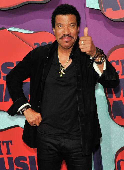 """Lionel Richie left the Commodores in 1982 and pursued a very successful career as a solo artist. Songs such as """"Hello"""" (1984) and """"Dancing on the Ceiling"""" (1986). He still performs today. Here, Lionel Richie arrives at the 2014 CMT Music awards at the Bridgestone Arena on June 4, 2014 in Nashville, Tennessee.  Photo: Frederick Breedon IV, Getty / 2014 Frederick Breedon IV"""