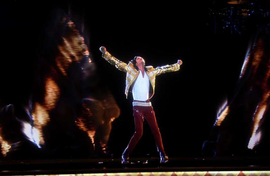 "Though Michael Jackson died in 2009, his image was resurrected via hologram at the 2014 Billboard Musiic Awards at the MGM Grand Garden Arena in Las Vegas, NV on May 18, 2014 to perform a song from his posthumous record, ""Xscape"" (2014). Photo: Kevin Winter/Billboard Awards 2014, Getty / 2014 Kevin Winter/Billboard Awards 2014"
