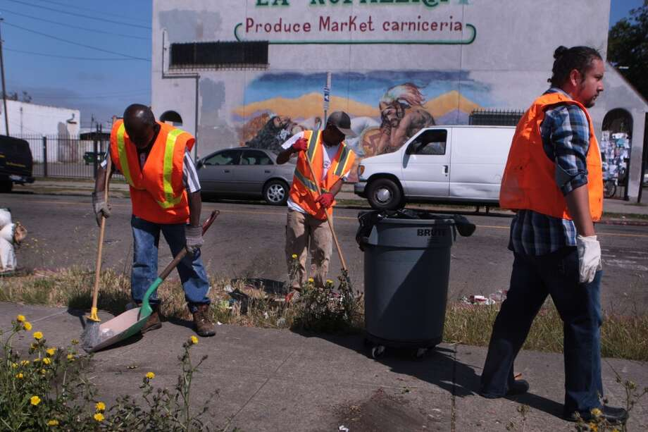 John Hopkins, left, Lonnie McClendon and Ramon Rios pick up trash and weeds near International Boulevard in East Oakland to help out Ken Houston as he cleans up and announces his run for mayor of Oakland on Tuesday, June 10, 2014 in Oakland, Calif. Photo: Kevin N. Hume, The Chronicle