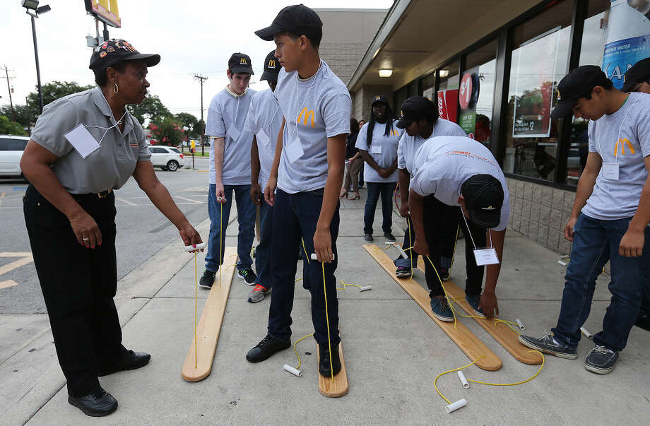 Northeast ISD teacher Carolyn James gives instructions to Xavier Estrada, 16, during a team-building exercise during the first day of a summer leadership camp operated by school districts and McDonald's owners. Photo: Jerry Lara / San Antonio Express-News / © 2014 San Antonio Express-News