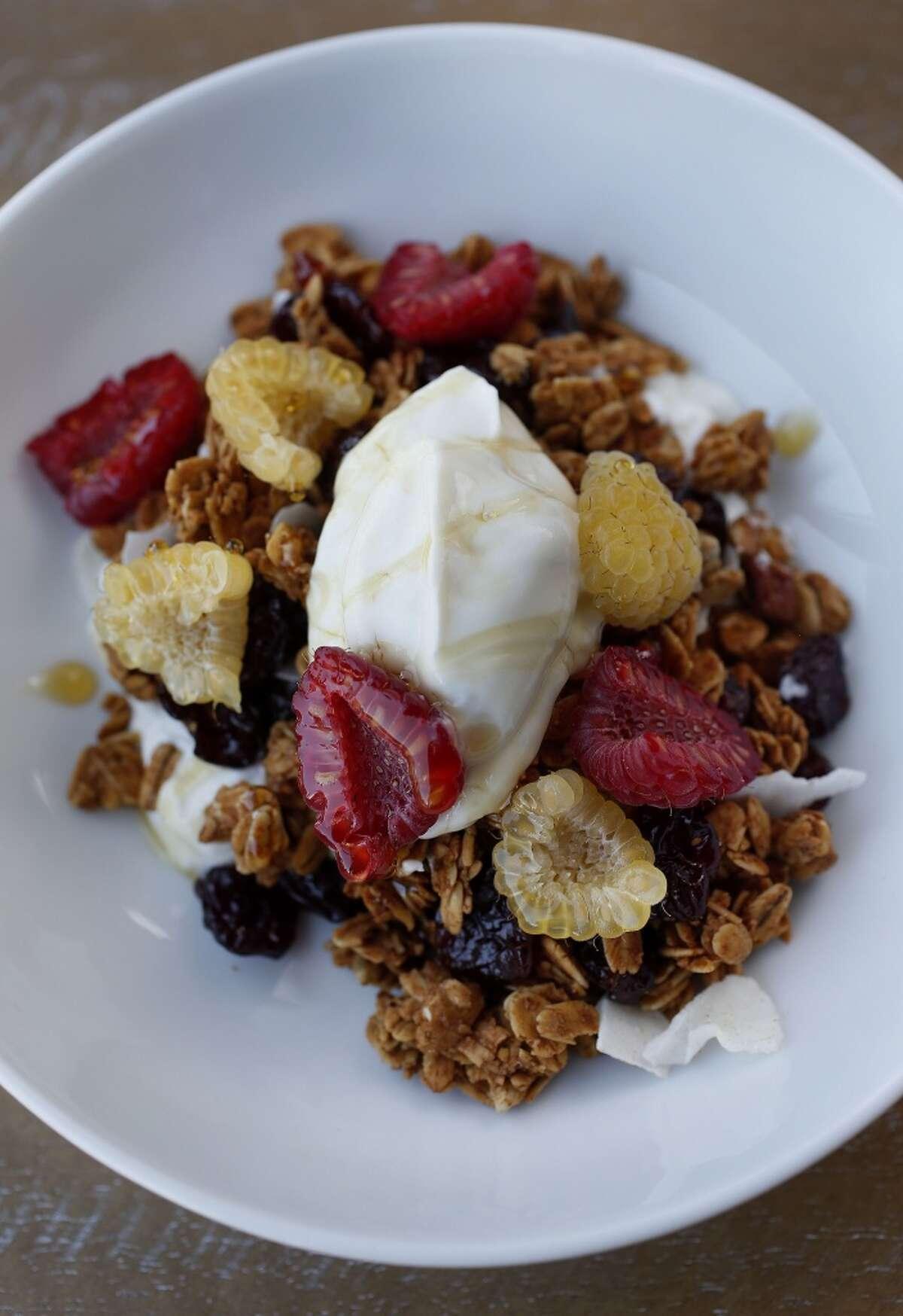 Yogurt and granola with honey and berries at Bosta Wine & Coffee.
