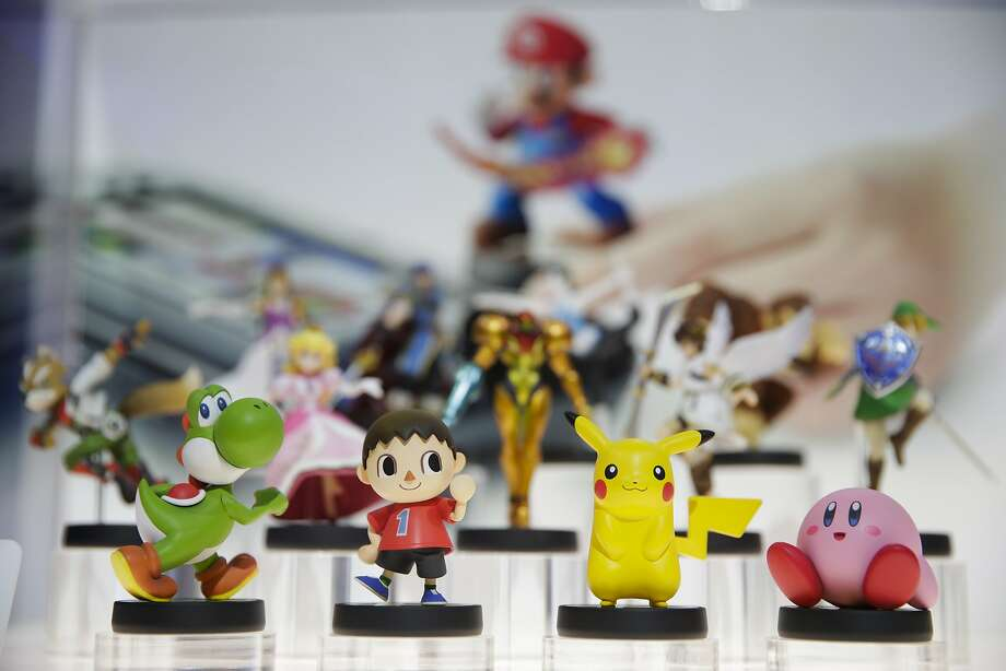 "An array of ""amiibo"" characters for Wii U are on display at the Nintendo booth during the Electronic Entertainment Expo in Los Angeles. Photo: Jae C. Hong, Associated Press"