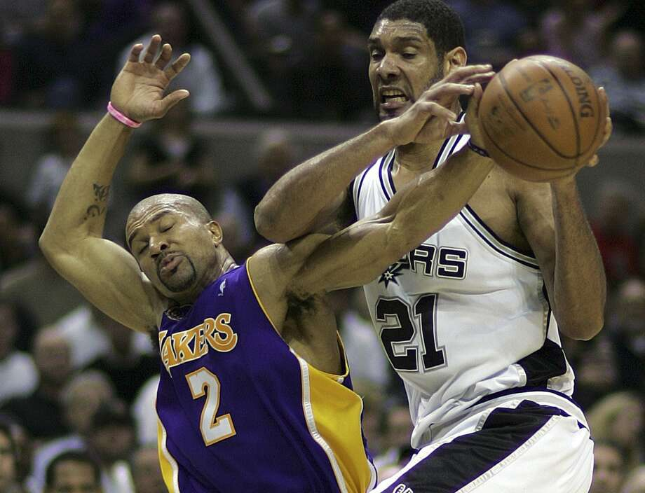 A look back to 2008 when Derek Fisher fouls Tim Duncan on a rebound attempt.Duncan currently holds the record for most career playoff defensive rebounds with 1,978.Duncan must love the Lakers because once again it was a Laker big man that Duncan moved past to get the record. This time ... Photo: BAHRAM MARK SOBHANI, SAN ANTONIO EXPRESS NEWS
