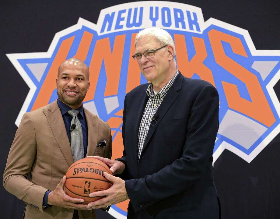 Knicks president Phil Jackson (right) gave his former point guard, Derek Fisher, a five-year, $25 million contract to become the team's new coach, a person with knowledge of the details said. Photo: Barton Silverman / New York Times / NYTNS