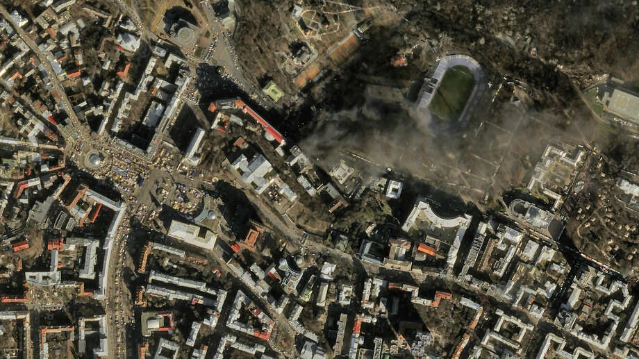 In this satellite image taken by SkySat-1 in February and provided by Skybox Imaging, smoke rises from the site of protests, upper center, in Kiev, Ukraine. Photo: Uncredited, HONS / Skybox Imaging