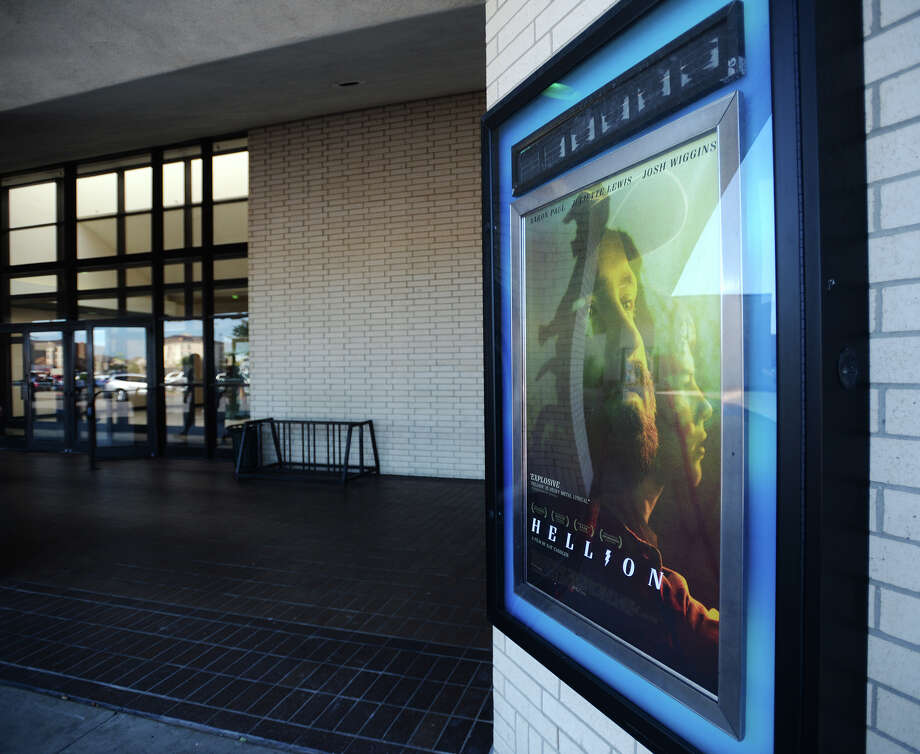 "A poster for ""Hellion"" is seen outside the Central Mall 10 cinema on Tuesday afternoon. The Central Mall 10 cinema in Port Arthur hosted two showings of the movie ""Hellion"" on Tuesday evening. Writer and director Kat Candler, producer Kelly Williams, and other crew and cast members attended the premiere of the locally shot film. Photo taken Tuesday 6/10/14 Jake Daniels/@JakeD_in_SETX Photo: Jake Daniels / ©2014 The Beaumont Enterprise/Jake Daniels"