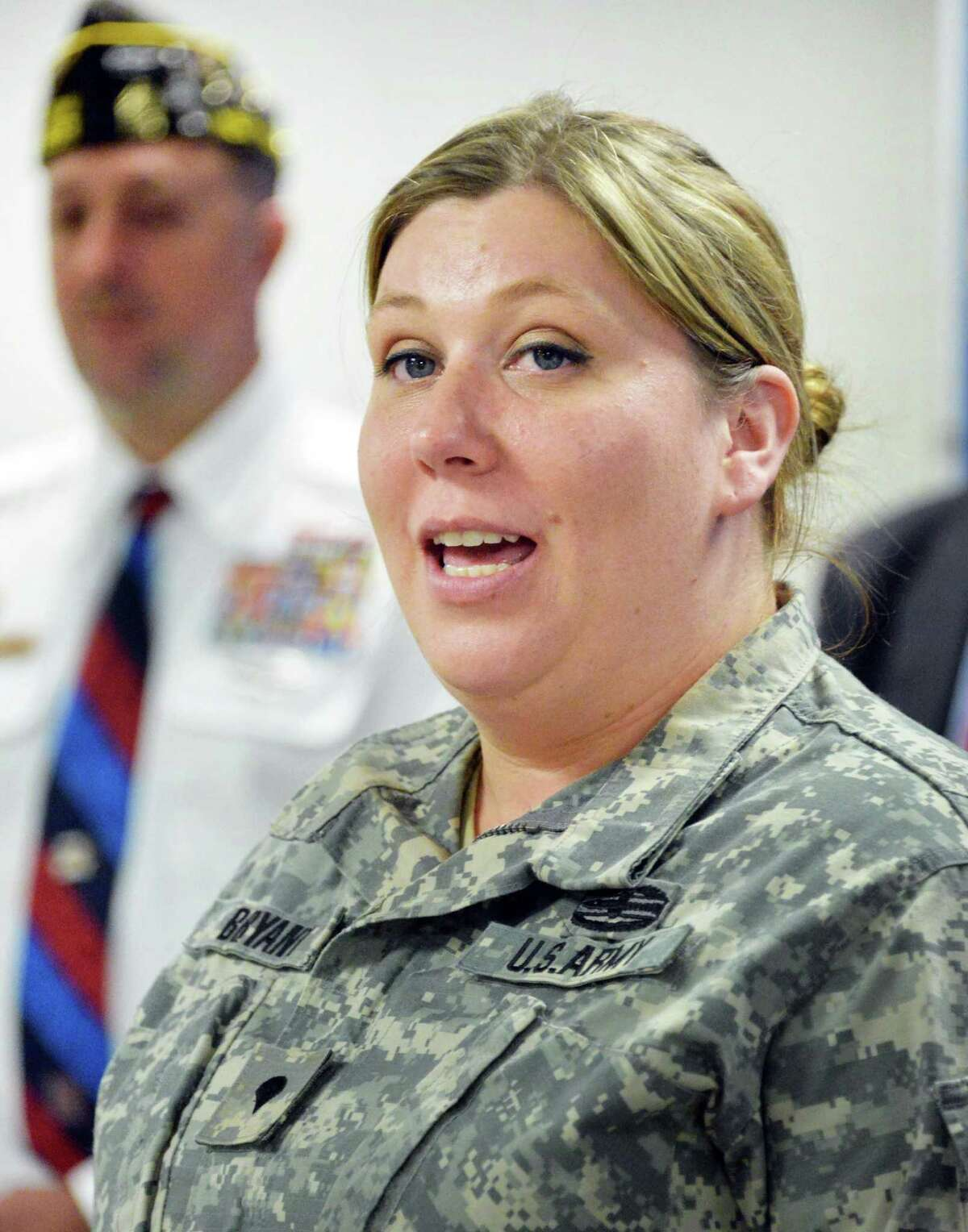 US Army MP Jennifer Nunnery of Batavia speaks during a news conference to urge legislators to pass a bill that helps veterans with mental health ailments in the criminal justice system Tuesday June 10, 2014, in Albany, NY. (John Carl D'Annibale / Times Union)