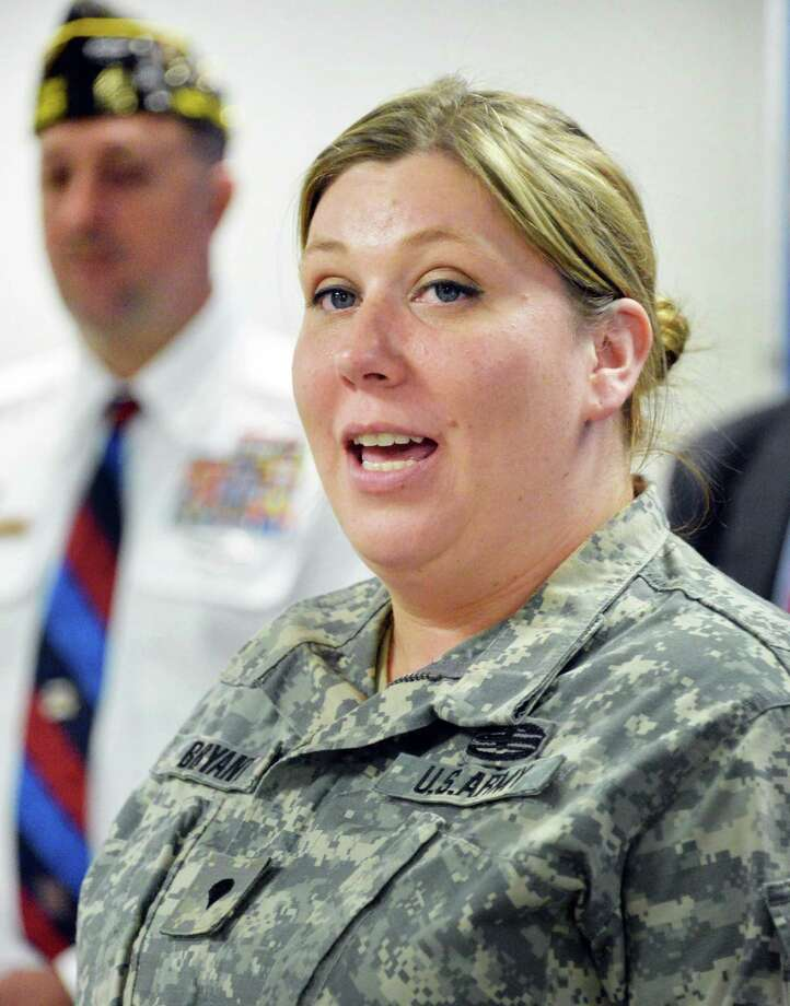 US Army MP Jennifer Nunnery of Batavia speaks during a news conference to urge legislators to pass a bill that helps veterans with mental health ailments in the criminal justice system Tuesday June 10, 2014, in Albany, NY.  (John Carl D'Annibale / Times Union) Photo: John Carl D'Annibale / 00027302A