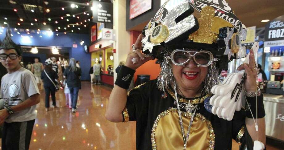 Sovia Lauriano is among a legion of Spurs fans cheering for what would be a pride-boosting title. Photo: Kin Man Hui / San Antonio Express-News / ©2014 San Antonio Express-News