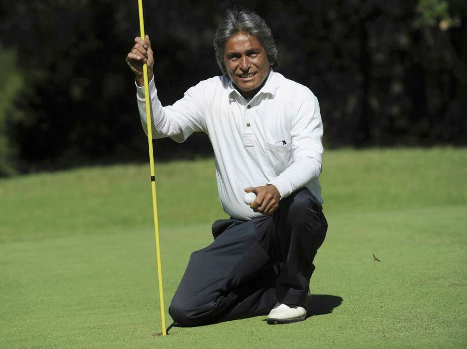 Frankie Gonzales has made five holes-in-one at Canyon Lake's Lakeside Golf Club. He's also beaten leukemia and alcoholism. Photo: Billy Calzada / San Antonio Express-News / San Antonio Express-News