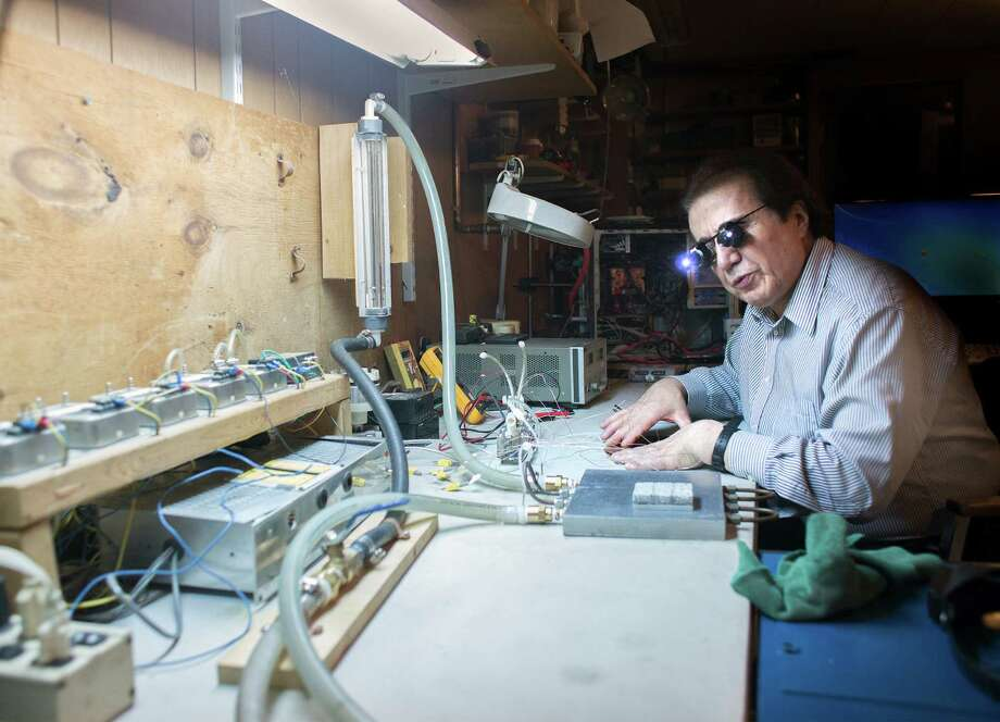 Burhan Ozmat examines Kapton Flexible Material on his basement workbench on Tuesday, June 10, 2014, inside his home in New Scotland, N.Y.  Ozmat is a Research and Development Consultant and a Mechanical-Materials engineer.  (Tom Brenner/ Special to the Times Union) Photo: Tom Brenner / ©Tom Brenner/ Albany Times Union