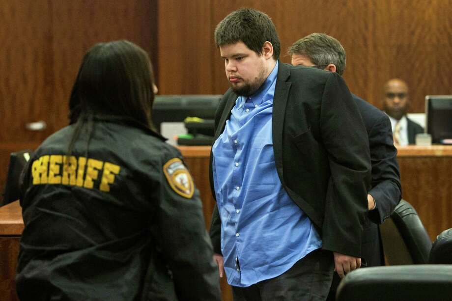Justin Wayne Parris, 27, leaves the courtroom during a break his murder trial at the Harris County Courthouse on Tuesday. Prosecutors allege Parris decapitated his grandfather with hedge clippers. Photo: Brett Coomer, Staff / © 2014 Houston Chronicle