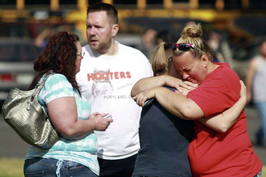 People wait for news about the safety of students at Reynolds High School in the Columbia River town of Troutdale, Ore., after the shooting. Photo: Faith Cathcart / Oregonian / The Oregonian