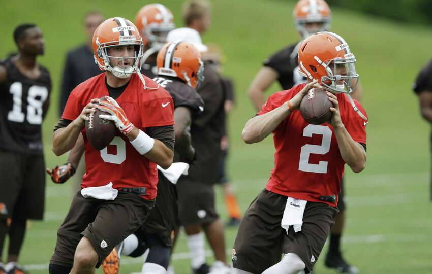 Browns starting QB Brian Hoyer (left) and backup Johnny Manziel go through drills during Tuesday's minicamp. Manziel is back at practice after partying in Texas, which didn't bother coach Mike Pettine.