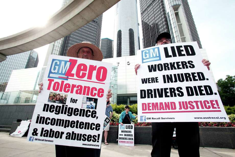"""Ken Parks, left, and Frank Hammer protest Tuesday in front of General Motors headquarters. GM's leader says a lawyer who specializes in victim compensation would """"independently determine"""" how many died in cars with faulty ignition switches. Photo: Bill Pugliano, Stringer / 2014 Getty Images"""
