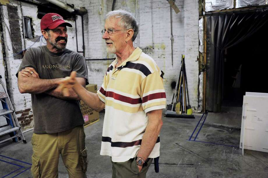Steven Patterson, left, and his husband John Sowle talks about their plans to turn a former factory into a home for their theater company on Monday, June 9, 2014, in Catskill, N.Y.  (Paul Buckowski / Times Union) Photo: Paul Buckowski / 00027225A