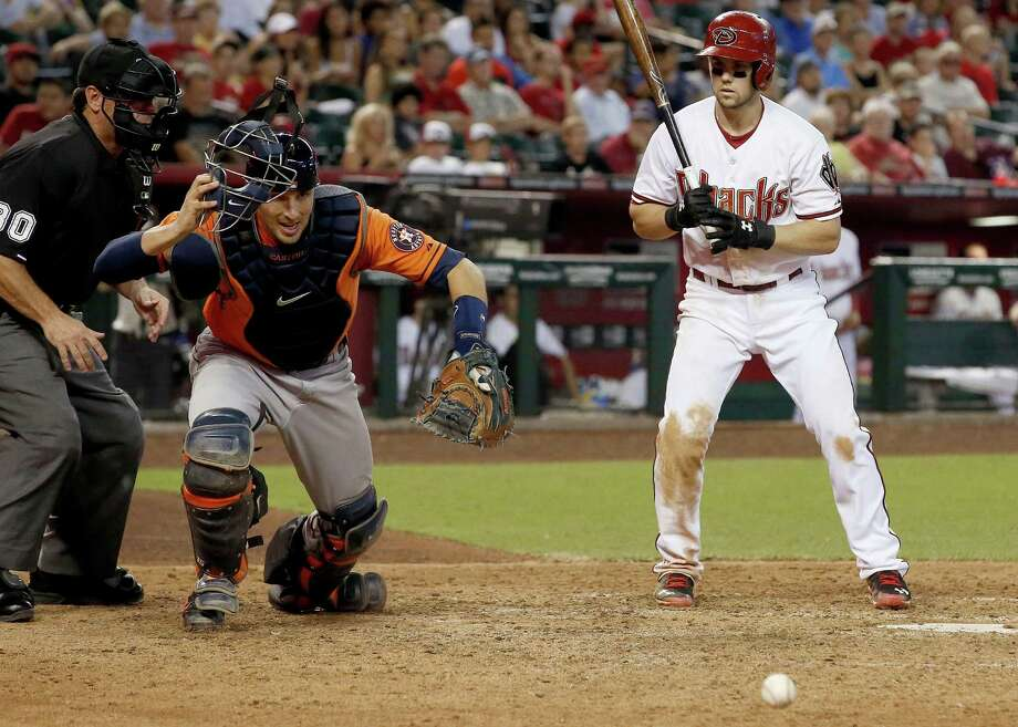 A passed ball by Jason Castro, left, was part of a sloppy seventh inning in which the Astros committed two errors and saw the Diamondbacks break a 1-1 tie. Photo: Ross D. Franklin, STF / AP
