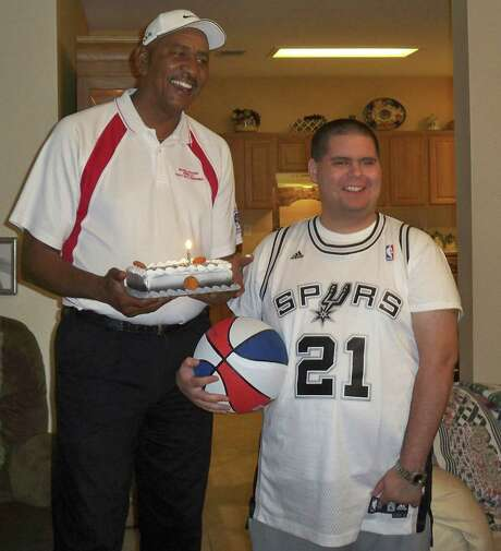 "Former Spur George ""The Iceman"" Gervin paid a surprise visit on Nathaniel Martinez, who'd always been a fan of the San Antonio team, in 2009. A few months later, Martinez died from cancer. Photo: Courtesy Photo"
