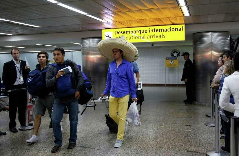 In this June 5, 2014 photo, foreigners arrive at the Guarulhos International Airport, in Sao Paulo,