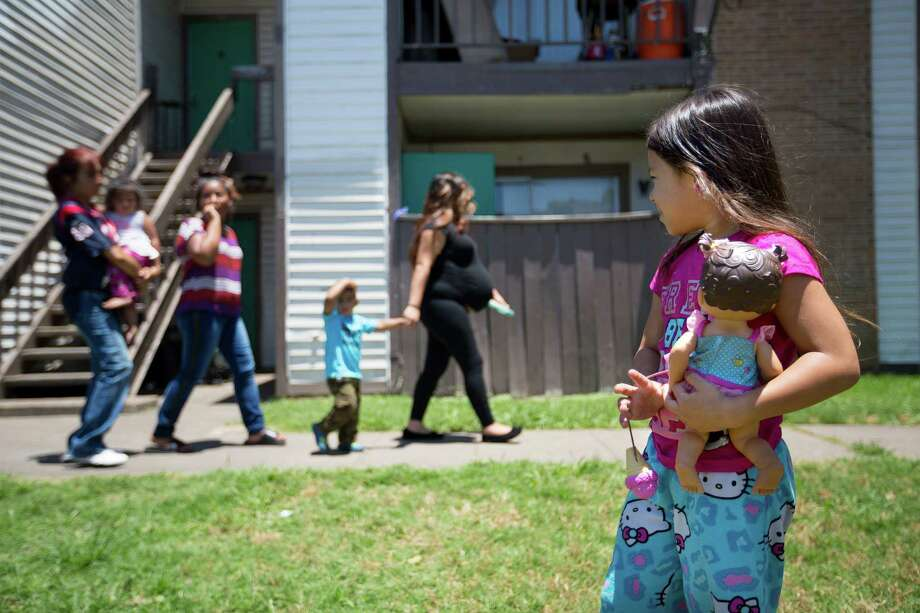 Shadow Melendez, 6, stands outside the house where Ayahna Comb's body was found June 9 in her mother's refrigerator. Photo: Johnny Hanson / © 2014  Houston Chronicle
