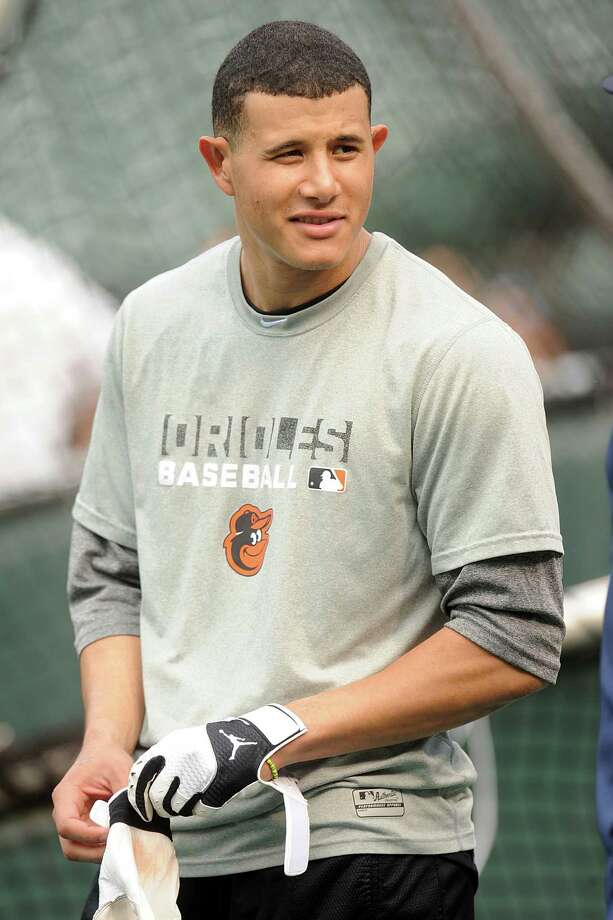 BALTIMORE, MD - JUNE 10:  Manny Machado #13 of the Baltimore Orioles looks on before a baseball game against the Boston Red Sox on June 10, 2014 at Oriole Park at Camden Yards in Baltimore, Maryland.  (Photo by Mitchell Layton/Getty Images) Photo: Mitchell Layton, Stringer / 2014 Getty Images