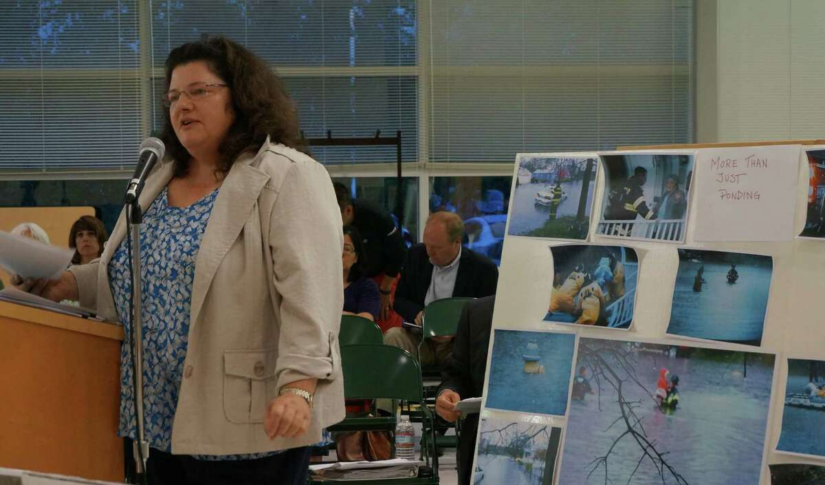 Kathy Braun, attorney for the Kings Highway Neighborhood Association, presents the neighbors' opposition to a proposed 33-unit apartment complex at the end of Berwick and Fairchild avenues at a Town Plan and Zoning Commission hearing Tuesday.