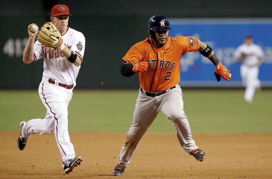 The Astros' Jonathan Villar (2) is chased by Diamondbacks second baseman Aaron Hill during a seventh-inning rundown that came on a botched steal attempt. Photo: Ross D. Franklin, STF / AP
