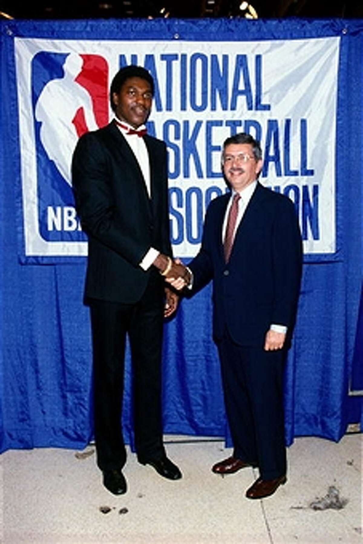 1984: NBA commissioner David Stern congratulates Akeem Olajuwon after being drafted first overall by the Houston Rockets during the 1984 NBA Draft. (Photo by Noren Trotman/NBAE/Getty Images)