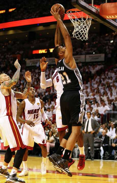 Tim Duncan gets inside against LeBron James for the type of shot that helped the Spurs shoot a record 75.8 percent in the first half and 59.4 percent for the game. Photo: Andy Lyons, Staff / 2014 Getty Images