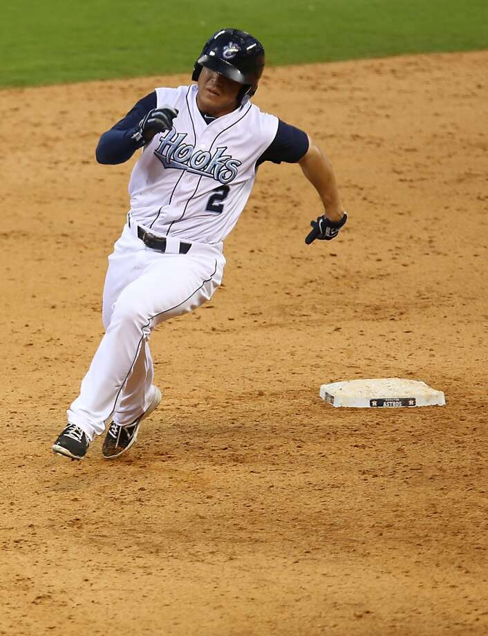 Corpus Christi Hooks Leo Heras rounds the bases after hitting a triple against San Antonio Missions during the fifth inning of Minor League Baseball game action at Minute Maid Park Tuesday, June 10, 2014, in Houston. ( James Nielsen / Houston Chronicle ) Photo: James Nielsen, Houston Chronicle