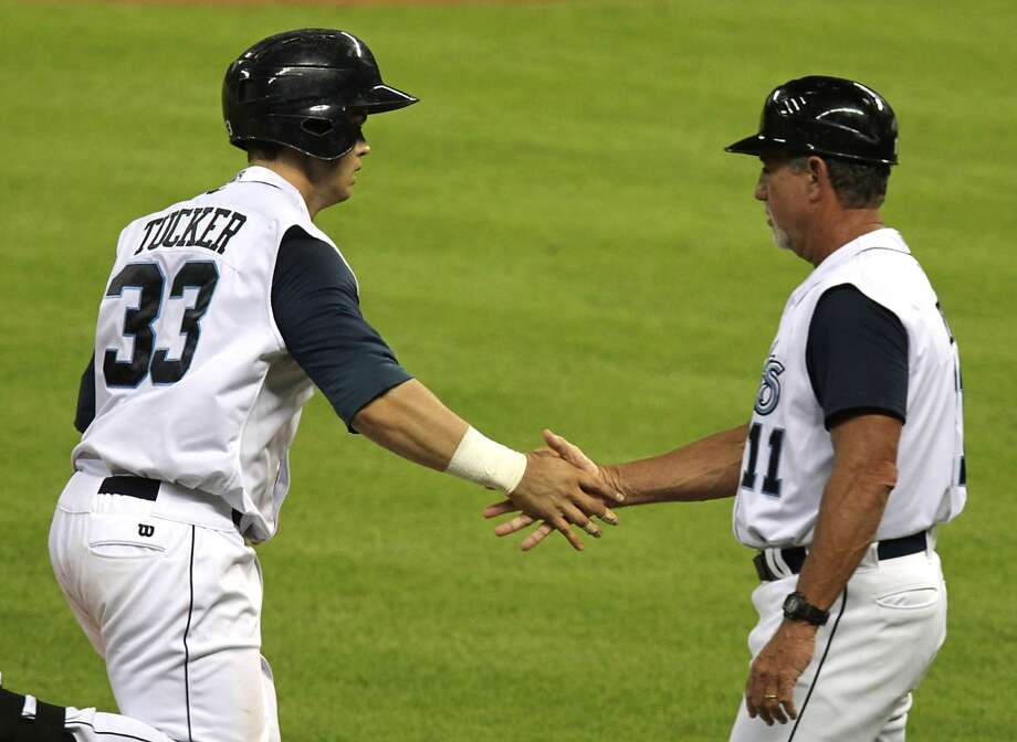 Corpus Christi Hooks Preston Tucker left, slaps hands with manager Keith Bodie right, as he rounds the bases after hitting a home run against San Antonio Missions during the eighth inning of Minor League Baseball game action at Minute Maid Park Tuesday, June 10, 2014, in Houston. ( James Nielsen / Houston Chronicle ) Photo: James Nielsen, Houston Chronicle