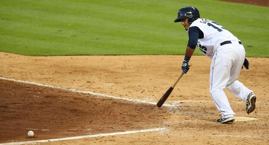 Corpus Christi Hooks Rene Garcia bunts the ball against San Antonio Missions during the fifth inning of Minor League Baseball game action at Minute Maid Park Tuesday, June 10, 2014, in Houston. ( James Nielsen / Houston Chronicle ) Photo: James Nielsen, Houston Chronicle