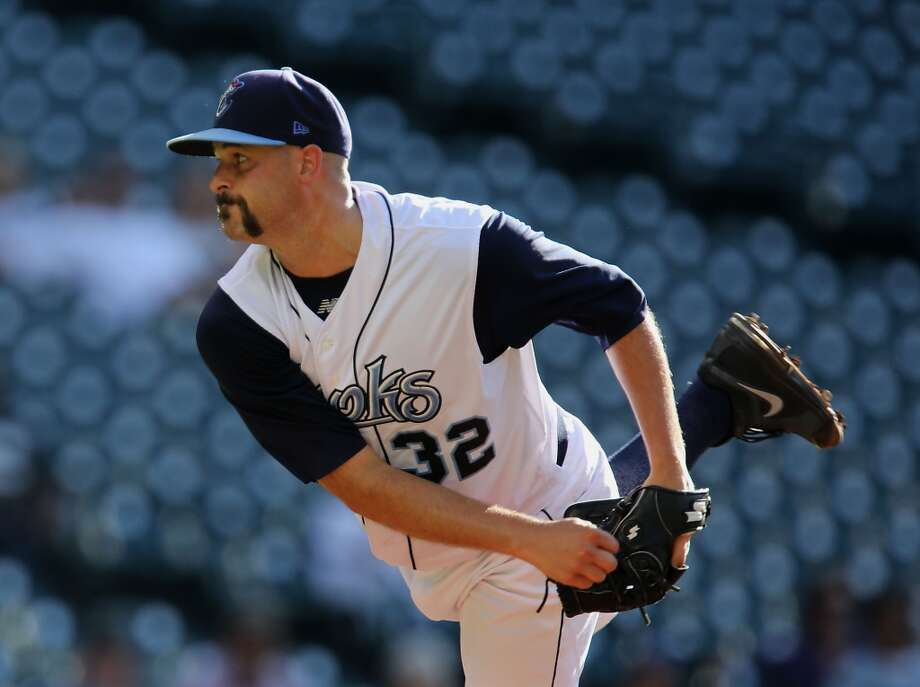 Corpus Christi Hooks Mike Hausechild throws a pitch against the San Antonio Missions during the first inning of Minor League Baseball game action at Minute Maid Park Tuesday, June 10, 2014, in Houston. ( James Nielsen / Houston Chronicle ) Photo: James Nielsen, Houston Chronicle