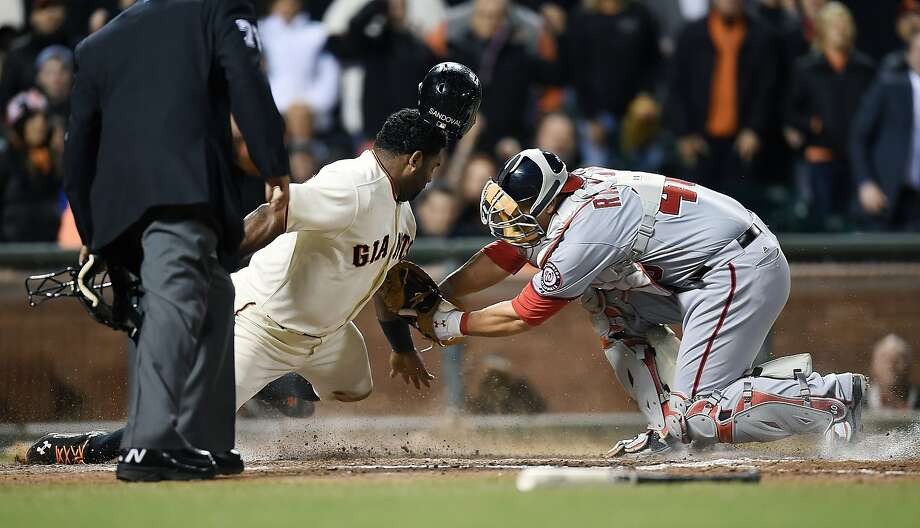 Pablo Sandoval is tagged out at home plate by catcher Wilson Ramos of the Nationals in the bottom of the sixth inning. Photo: Thearon W. Henderson, Getty Images