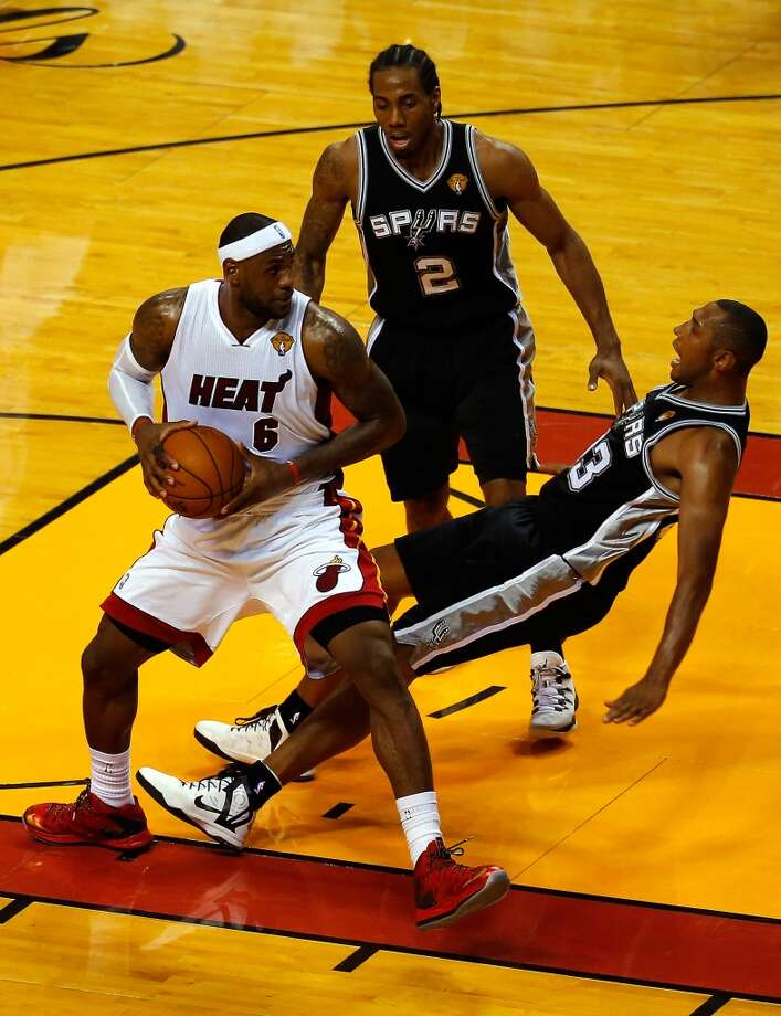 Game 3: Spurs 111, Heat 92 Spurs lead series 2-1  LeBron James collides with Boris Diaw. Photo: Chris Trotman, Getty Images