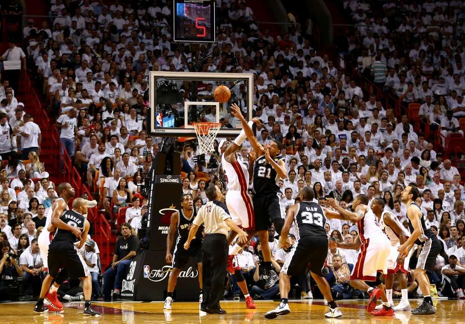 LeBron James and Tim Duncan battle for a jump ball. Photo: Andy Lyons, Getty Images