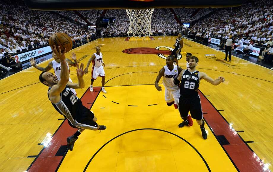 Spurs guard Manu Ginobili (20) goes to the basket against the Heat. Photo: Steve Mitchell, Associated Press