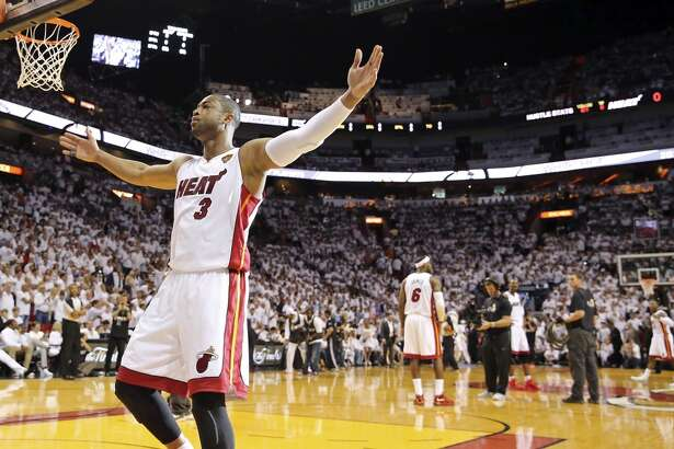 Miami Heat's Dwyane Wade reacts before Game 3 of the NBA Finals against the San Antonio Spurs Tuesday June 10, 2014 at American Airlines Arena in Miami, Fla.