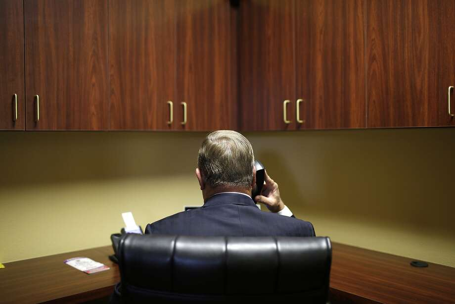Cresent Hardy, GOP candidate for the 4th congressional district, makes phone call at his office Tuesday, June 10, 2014 in Las Vegas. Hardy faces Niger Innis in the primary. (AP Photo/John Locher) Photo: John Locher, Associated Press
