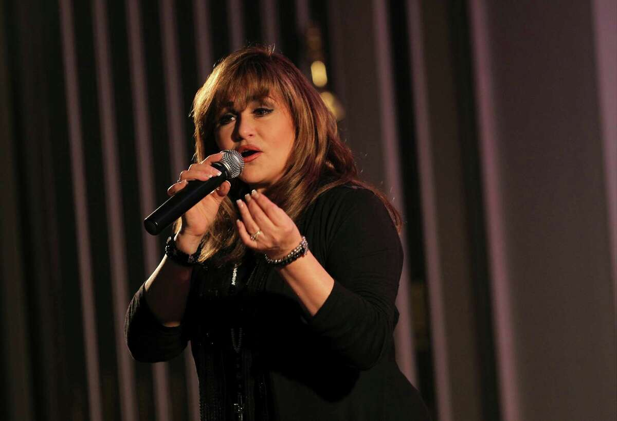 Patsy Torres performs during the Tejanos for Christ concert on Tuesday, June 10, 2014, at St. Mary Magdalen Catholic Church in San Antonio.